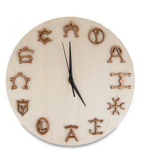 Horloge murale avec des fers taurins
